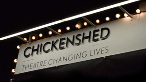 Chickenshed Logo Lit at Night